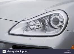 2008 Porsche Cayenne - 2008 porsche cayenne v6 in silver headlight stock photo royalty