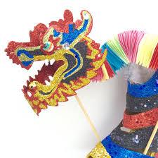 chinese dragon dance wedge glitter buzz nola