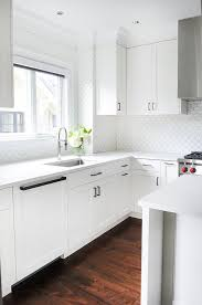 white kitchen cabinets with white backsplash white kitchen with stainless steel dome vent transitional