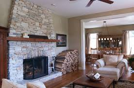 fireplace for living room stacked stone fireplace designs and the decors around them