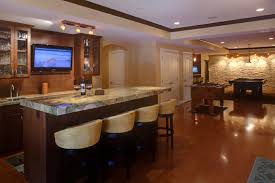 large basement kitchen room area feat wooden cabinets storage and