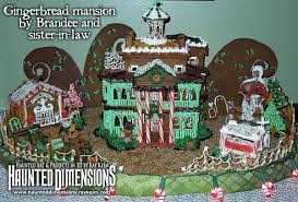 baking enthusiasts skillfully create a gingerbread mansion home