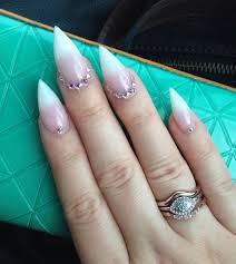 fierce stiletto french tip manicure with swarovski crystals by