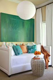 upholstered daybed in living room beach style with drum table next