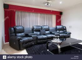 home theater recliner home theater room with black leather recliner chairs red curtains