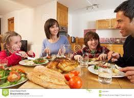 family lunch together in kitchen royalty free stock
