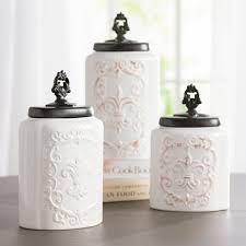 beige fleur de lis ceramic kitchen canisters set 3 by one allium way fleur de lis 3 piece kitchen canister set reviews