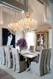 impressive dining room beamed ceiling and crystal chandeliers love