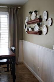 paint a neutral color above white beadboard wainscoting in the