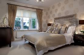 comfortable beige themed bedroom with beautiful round pattern wall