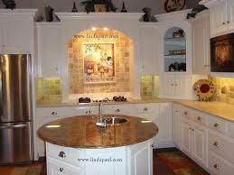 granite island kitchen white kitchen with a tuscan backsplash granite island