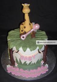 giraffe baby shower cake frostings by judy baby showers giraffe with pink rattle baby