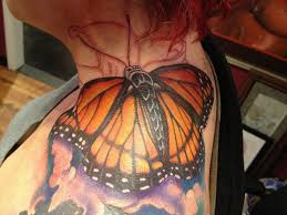 small sun and moon meaning monarch butterfly on