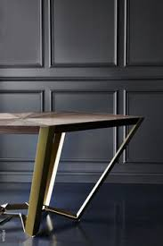 union bureau de change pentagon table by bureau de change architects walnut and brass