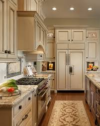 cream cabinets with light countertops u0026 a dark center island