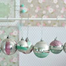 painted cheap plastic baubles are given a makeover with nail