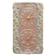 terracotta outdoor clock and thermometer terracotta garden wall