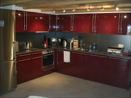 kitchens with cream cabinets with dark countertops the most