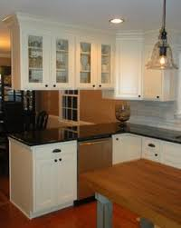 double sided kitchen cabinets hanging cabinets from ceilng over peninsula home pinterest