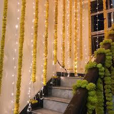 wedding home decor marigold flower and fairy lights home decor ideas during wedding ha