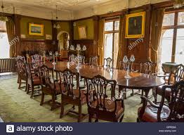 the dining room inside kinloch castle isle of rum scotland uk