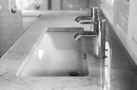 trough sink with 2 faucets 2 faucets on 1 sink transitional bathroom cory connor design