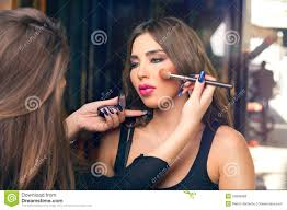 professional make up makeup artist applying make up on beautiful model stock images