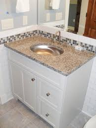 travertine subway tile kitchen backsplash with a mosaic glass at