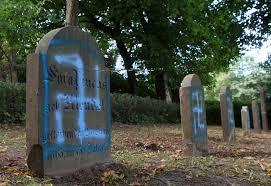 cemetery stones rostock germany swastikas sprayed on tombstones in kroepelin