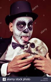 mexican halloween makeup a man with mexican calaveras makeup wearing bow tie and top hat