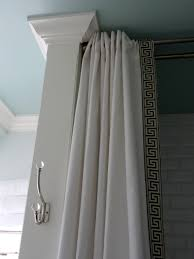 bathroom use ceiling mounted shower curtain rods as your