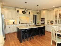 ivory kitchen cabinets cream kitchen cabinets with black island