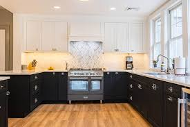 two tone kitchen cabinets with black countertops using color for eye catching two tone kitchen cabinets