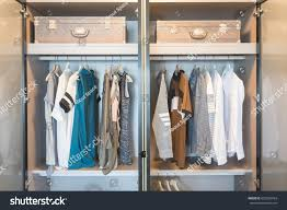 clothes hanging on rail modern wardrobe stock photo 622569764