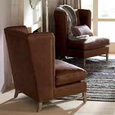High Back Wing Chairs For Living Room by Groucho High Back Aged Leather Wing Chair Oka