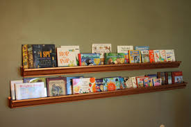 rain gutter turned book shelf renoviert