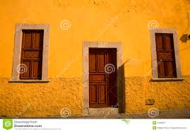Adobe House by Yellow Adobe House Brown Doors Morelia Mexico Royalty Free Stock