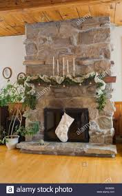 Decorating Living Room With Stone Fireplace Living Room Natural Stone Fireplace With Christmas Decorations In