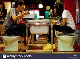 Modern Toilet by A Young Couple Enjoys Dinner At Modern Toilet Restaurant In Stock