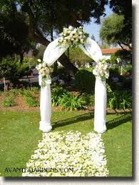 wedding arches toronto garden arch with white draping and flowers wedding arch ideas