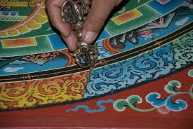 tibetan monks create wildly intricate sand painting before