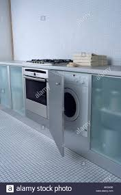Close Up Of Oven And Built In Washing Machine In Modern Kitchen