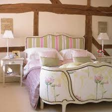 country style bedroom with striped floral bed frame country