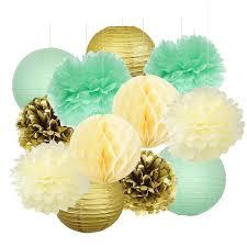 mint green tissue paper set of 12 mint green gold ivory tissue paper pom poms honeycomb
