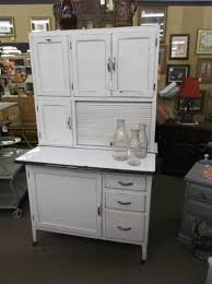 sold hoosier style kitchen cabinet with enamel pull out flour