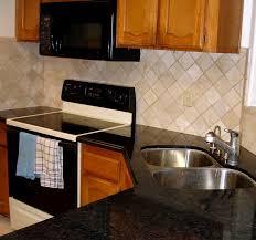 Backsplash For Black Granite by Small L Shape Kitchen Decoration Using Diagonal Cream Travertine