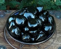 jet black amber tumbled fossilized gemstone