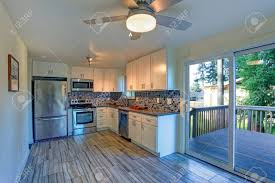white kitchen cabinets with brown floors l shape kitchen room design with white cabinets brown granite