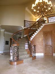 custom iron and cherry curved staircase by master woodworks inc