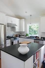 white kitchen cabinets with black countertops coastal cottage kitchen update color concierge